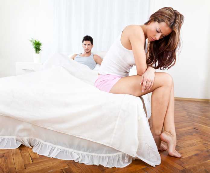 Young couple having relationship difficulties in the bedroom