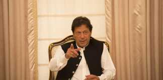 FILE -- Prime Minister Imran Khan of Pakistan speaks with journalists at his residence in Islamabad.