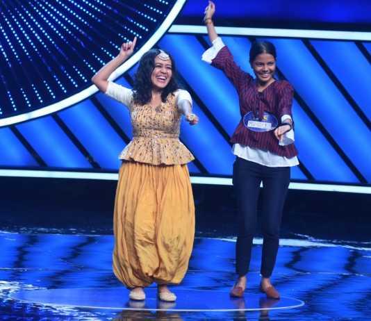 Neha Kakkar dancing with a contestant