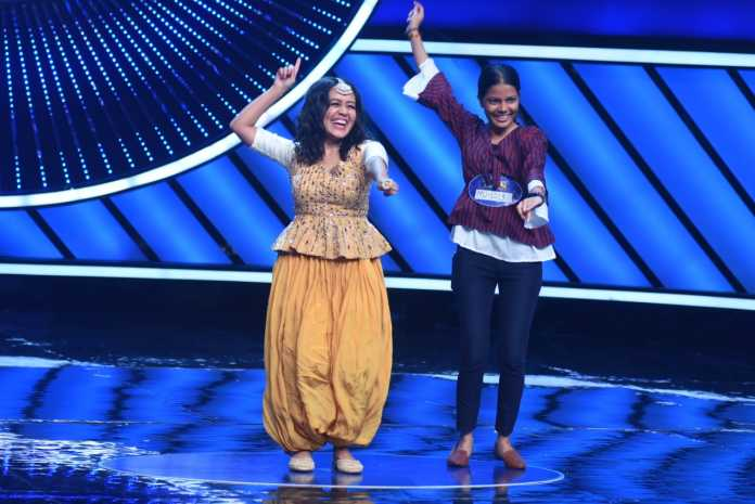 Neha Kakkar dancing with a contestant