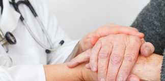 patient-and-doctor-hold-hands